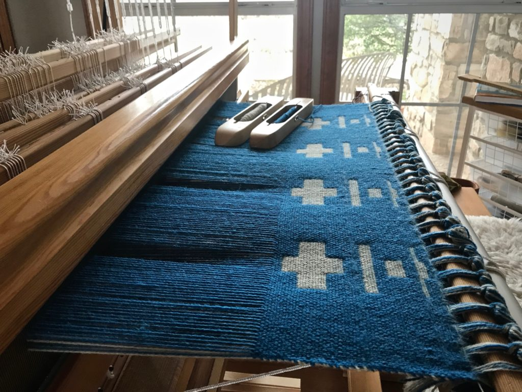 Blue wool double weave blanket on 12 shafts.