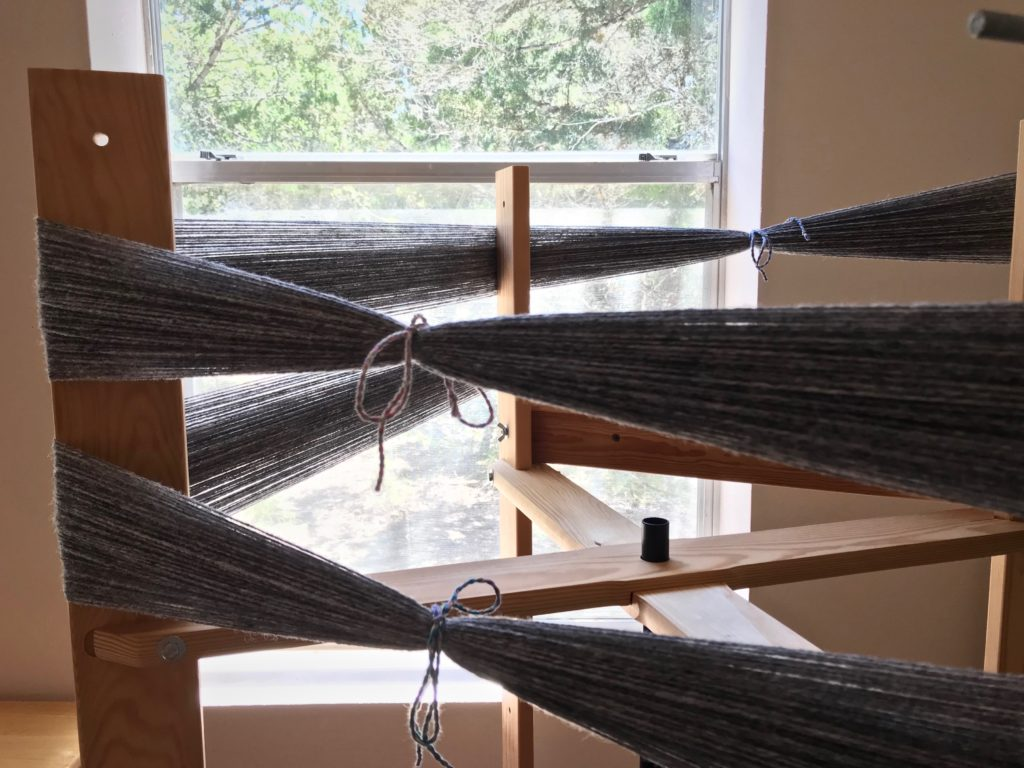 Winding warp on the warping reel.
