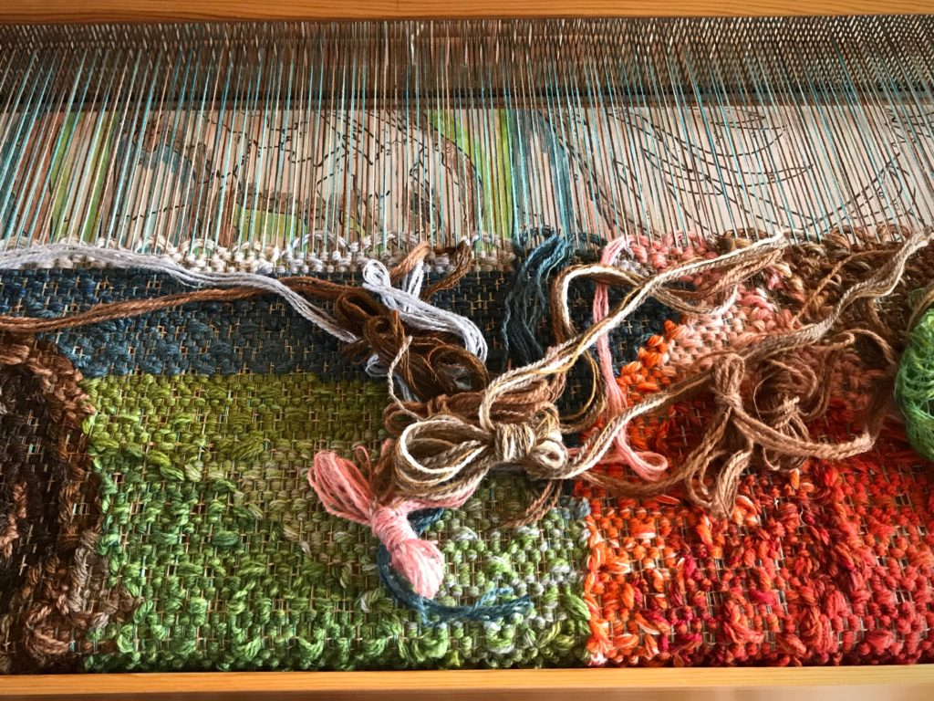 Beginning the bunny in the large pictorial tapestry.