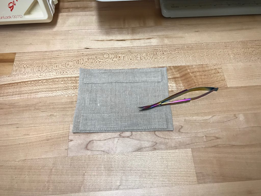 Linen backing for mounting a small tapestry weaving.