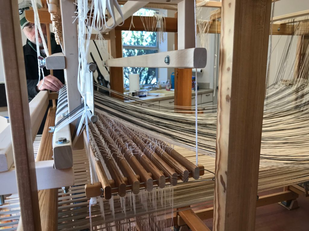 Placing the single-unit reed on the drawloom.