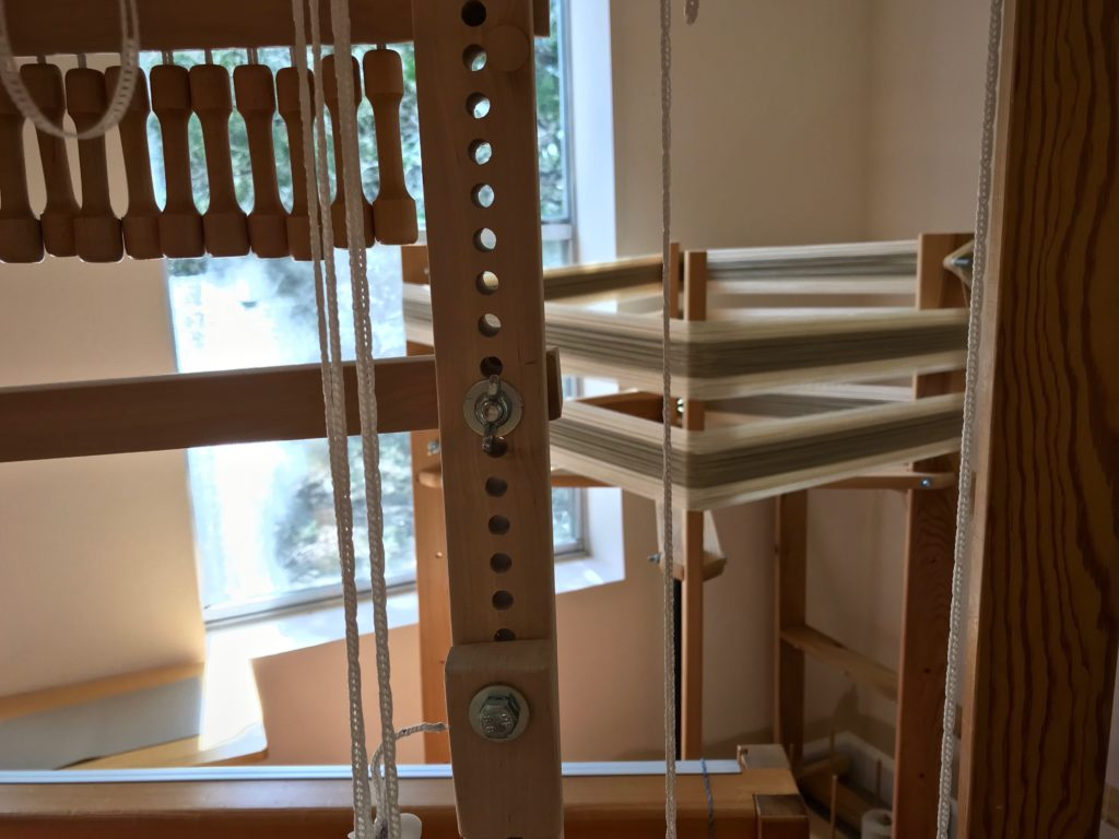 Winding a warp for the next drawloom project.