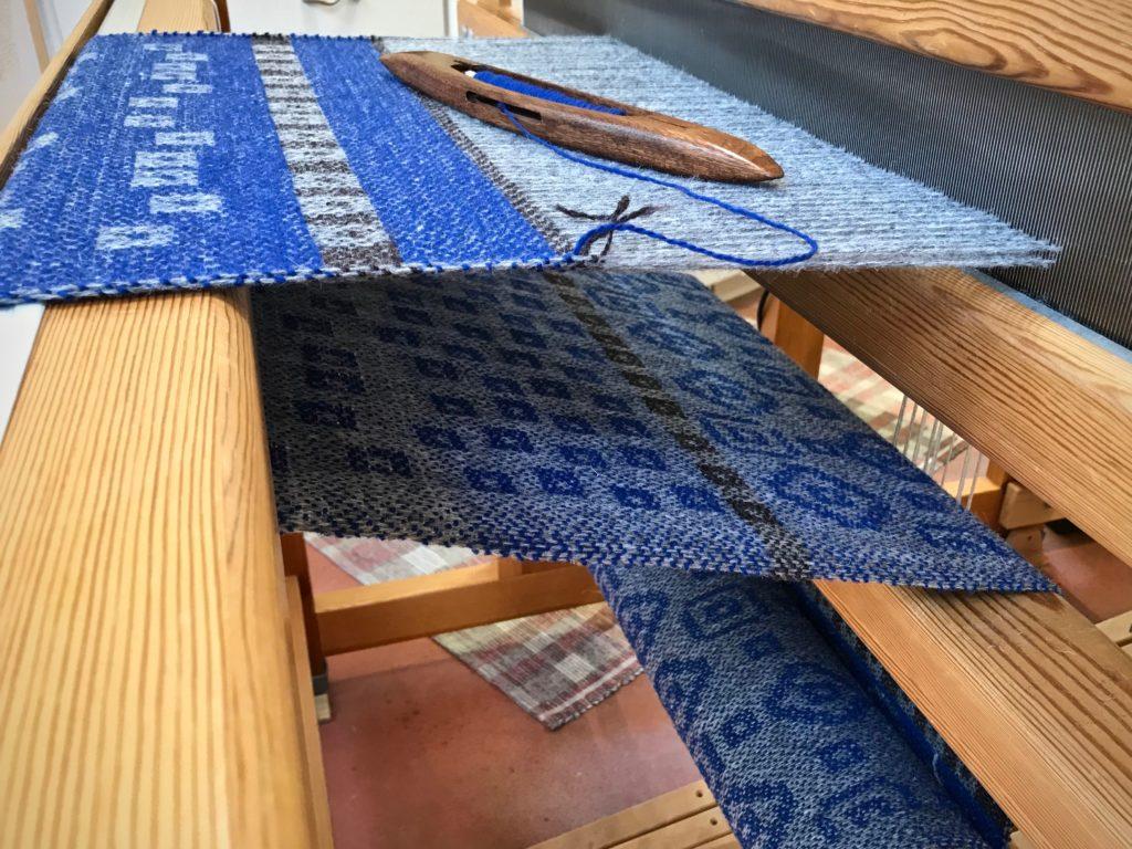 Weaving garment fabric on the drawloom.