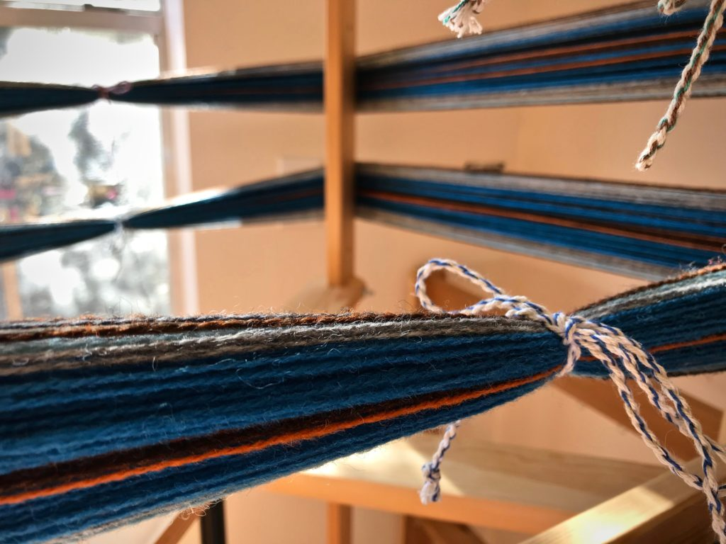 New warp on warping reel for winter scarves.