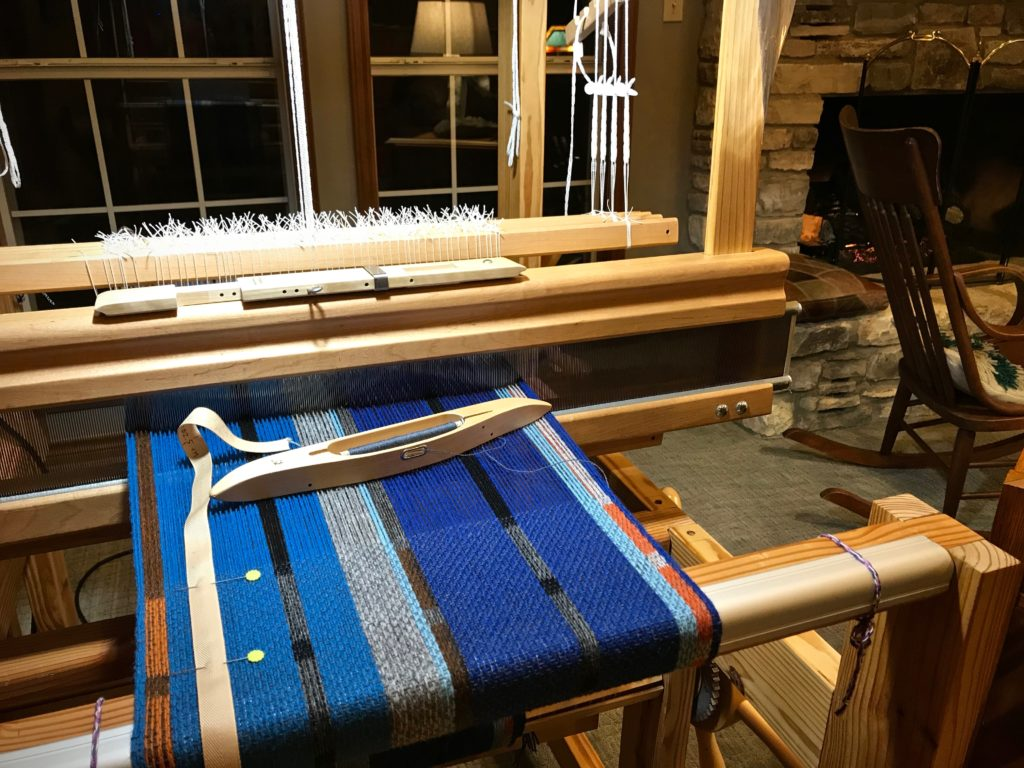 Weaving by the fire in the middle of winter.