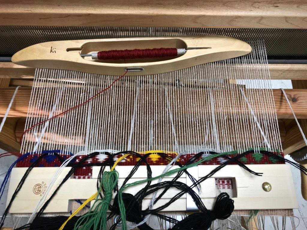 Weaving Krabba, a Swedish art weave.