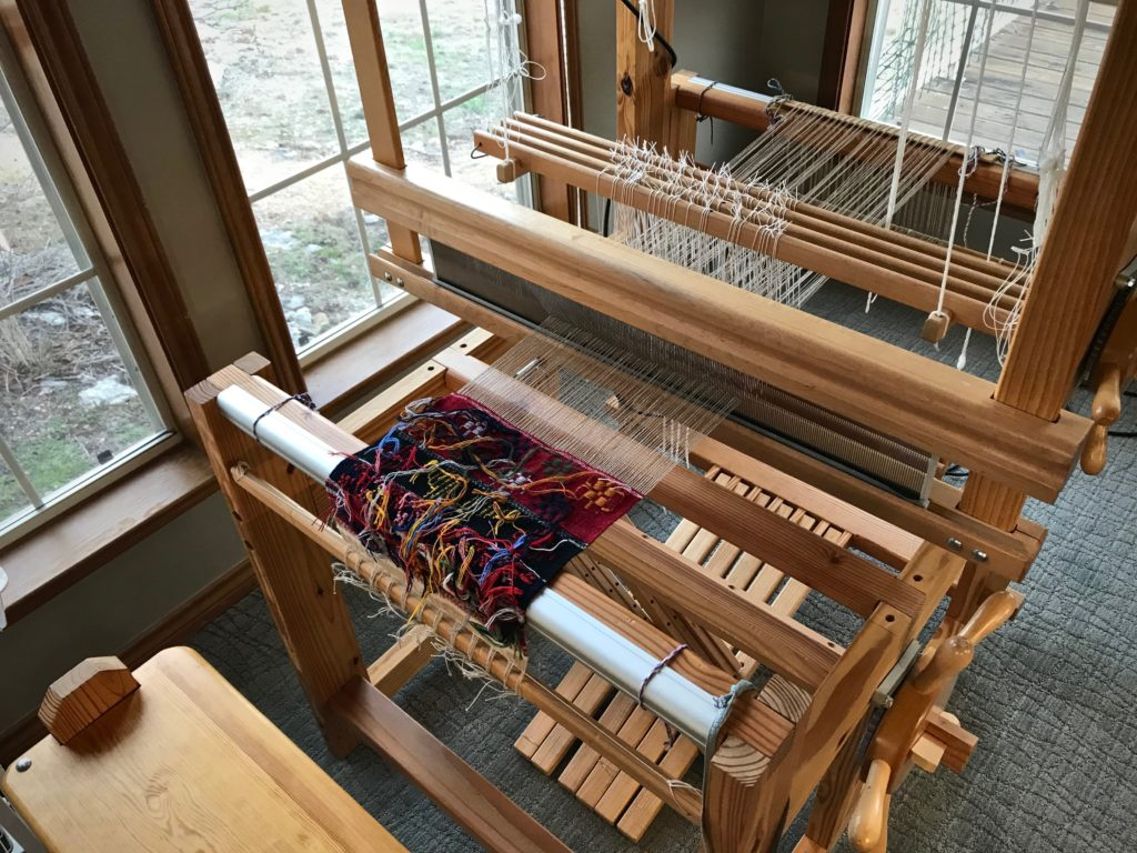 Weaving Swedish art weaves from the back.