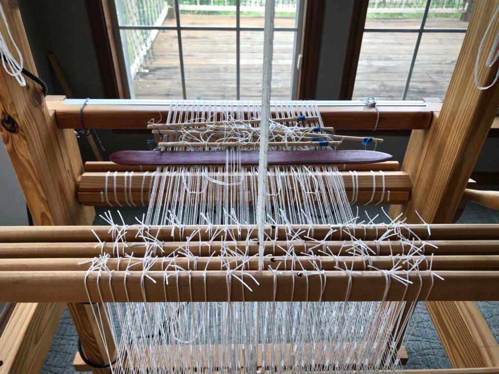 Weaving Monksbelt with half heddle sticks.