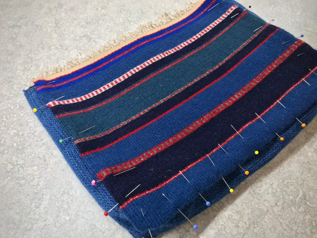 Handwoven wool bag construction.