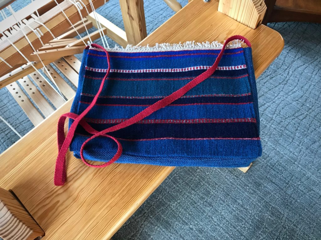 Handwoven shoulder bag.