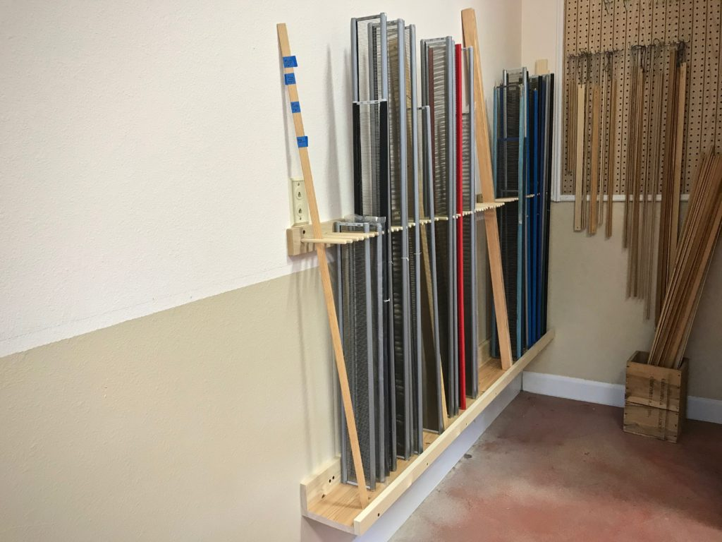 Reed holder stores weaving loom reeds. DIY