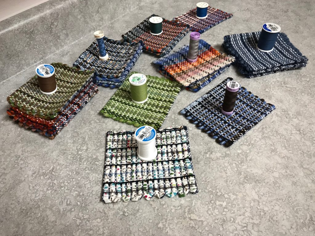 Making handwoven mug rugs.
