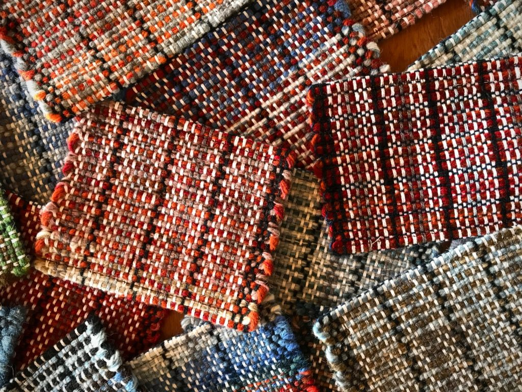 Handwoven wool coasters woven on a rigid heddle loom.
