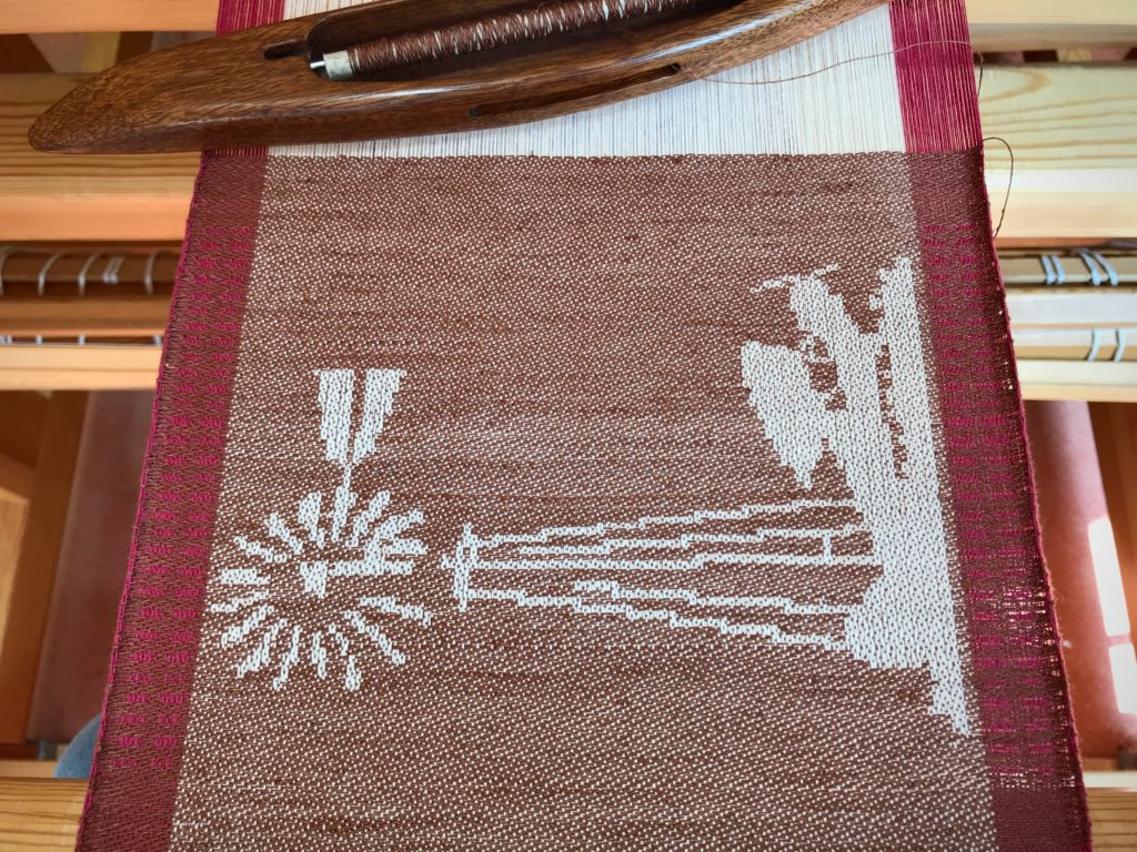 Windmill and taildragger woven on the drawloom.