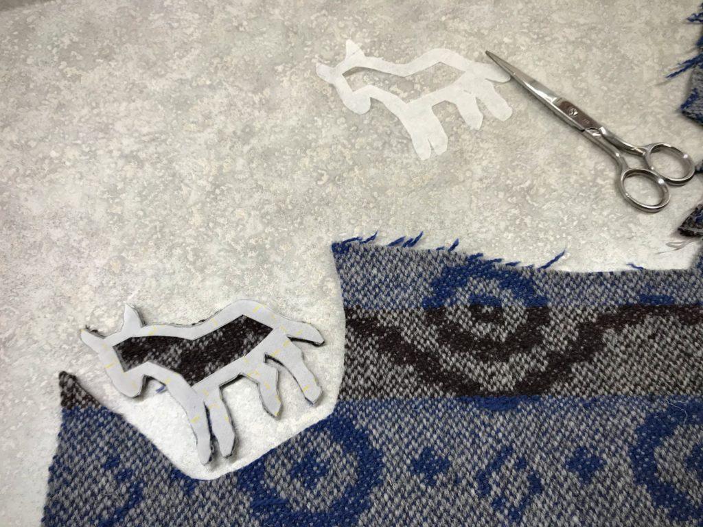 Handwoven remnants cut for applique Nativity.