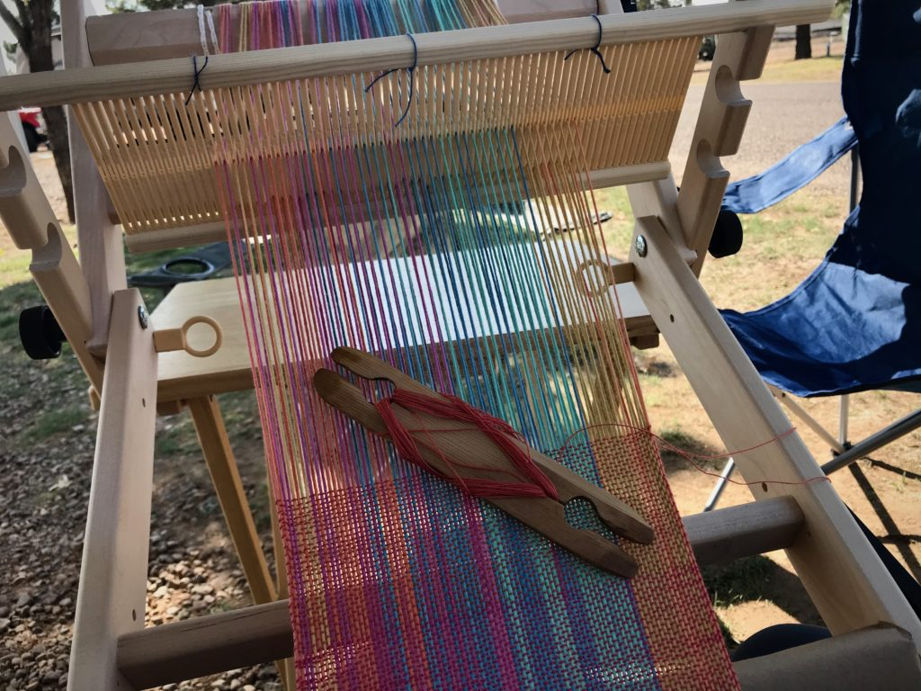 Weaving outside while camping.