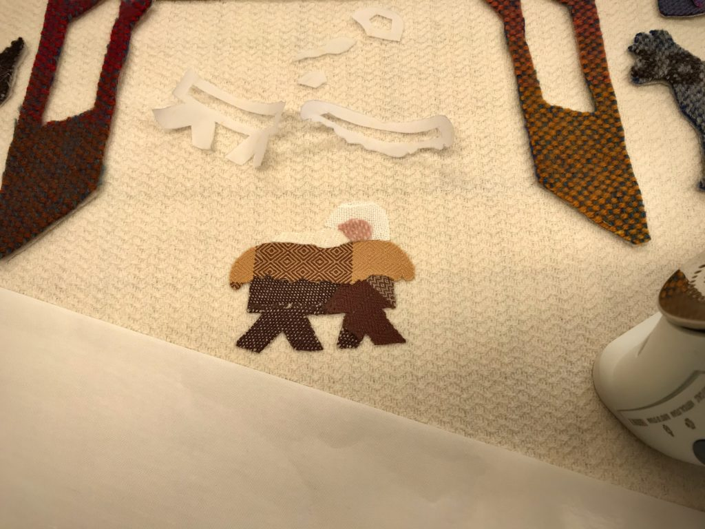 Making a handwoven applique Nativity scene.