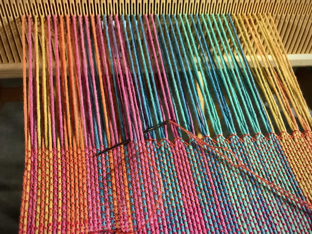 Hemstitching at the end of a scarf on the rigid heddle loom.