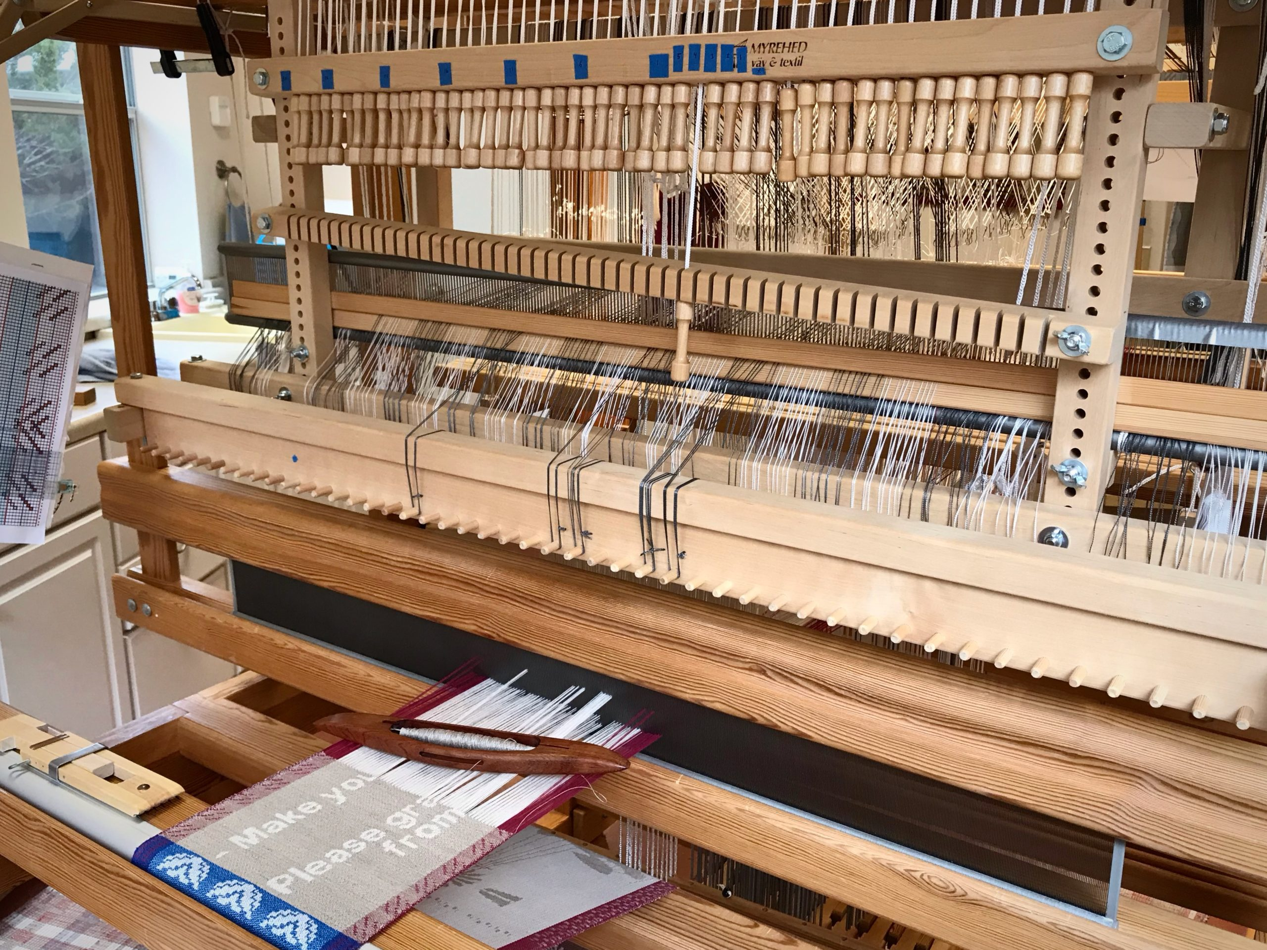 Weaving on the combination drawloom.