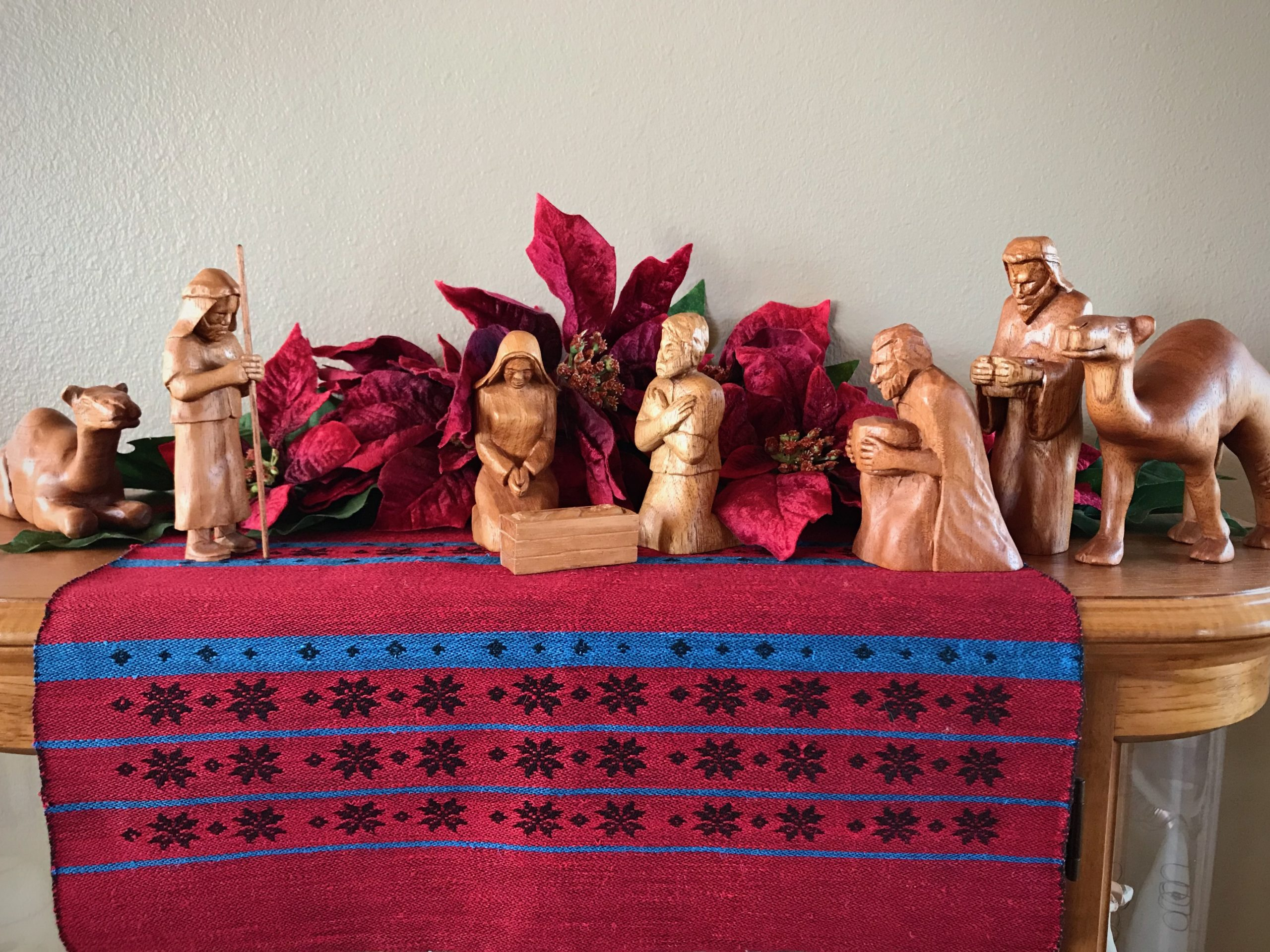 Hand-carved Nativity. Drawloom-woven runner.