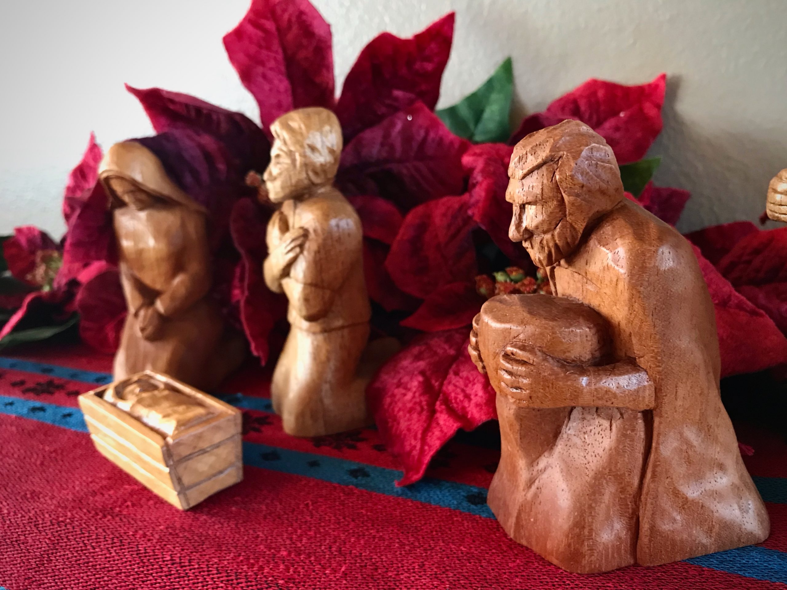Kneeling wise man is added to hand-carved nativity.