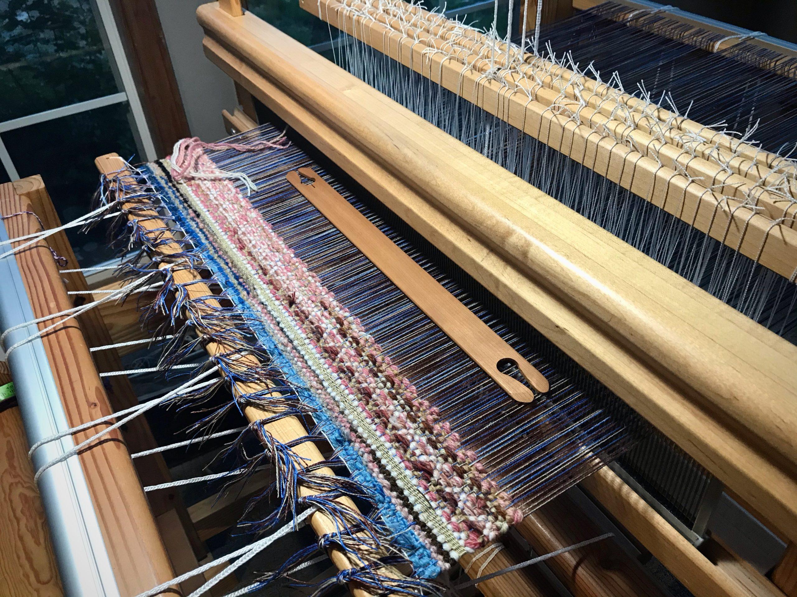 Linen warp and wool weft in rosepath.