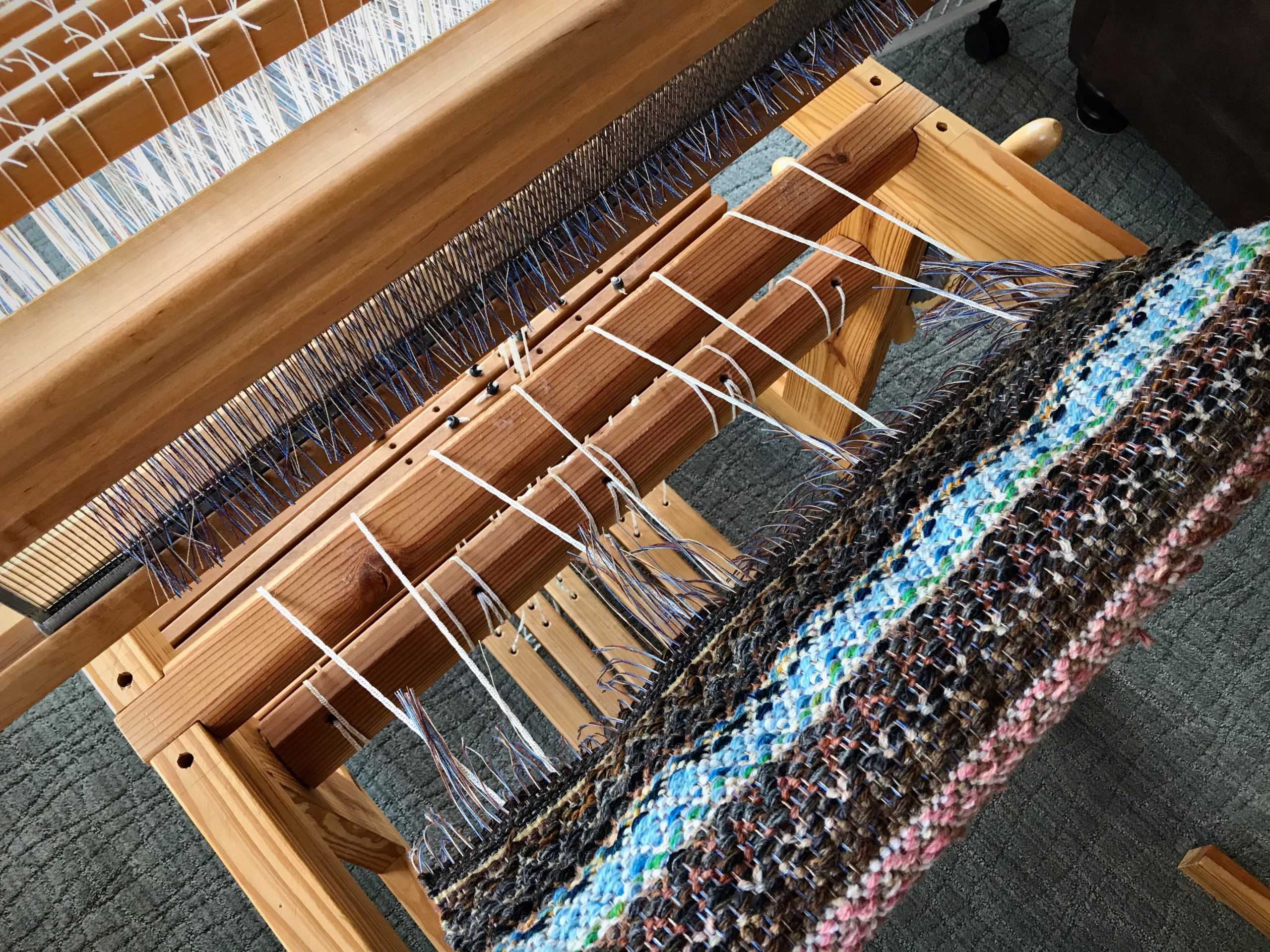 Cutting off beautiful linen and wool rosepath!