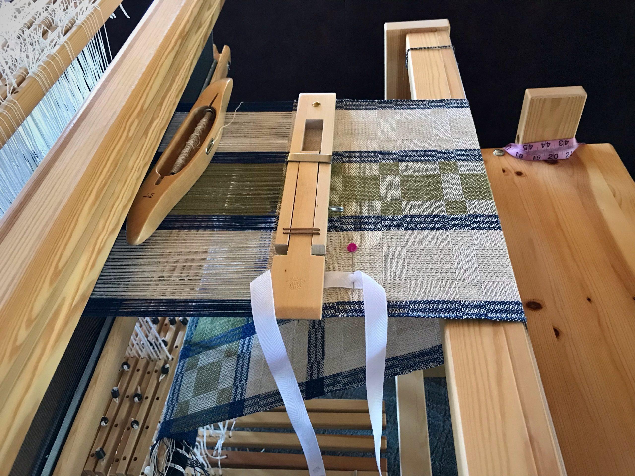 Weaving a linen table runner.