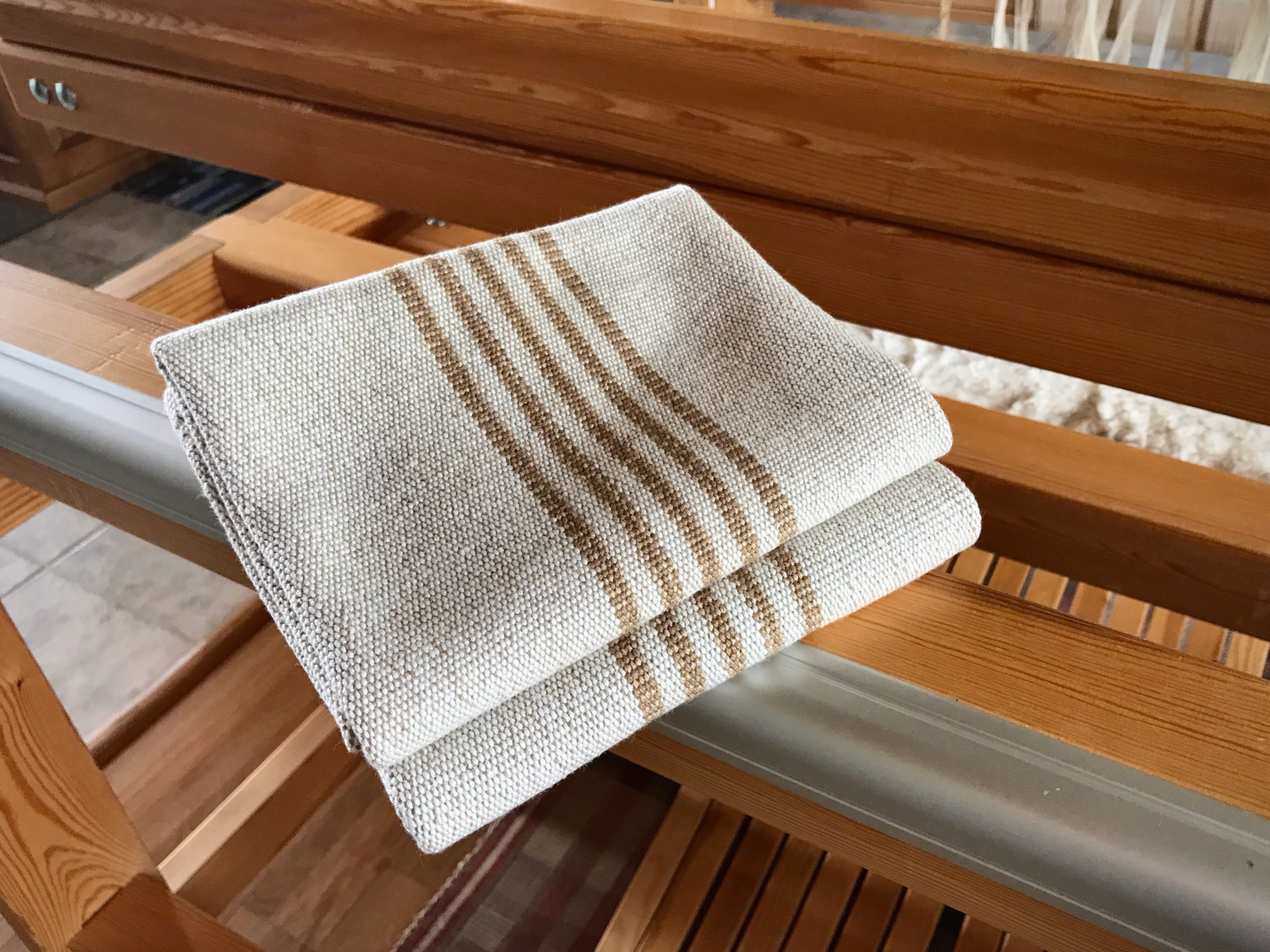 Natural colored cotton dish towels woven at Homestead Fiber Crafts.