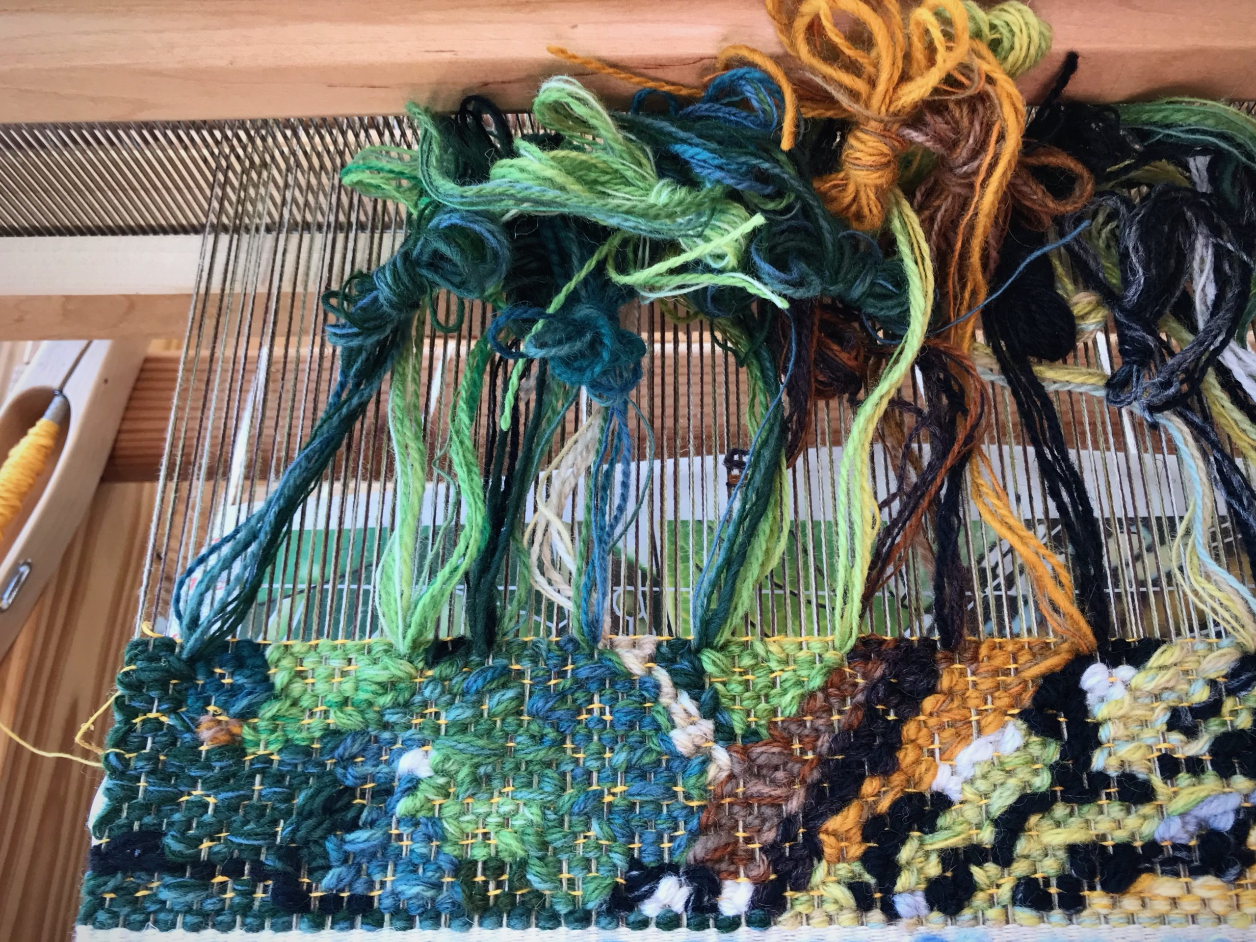 Weaving a new tapestry on the floor loom.