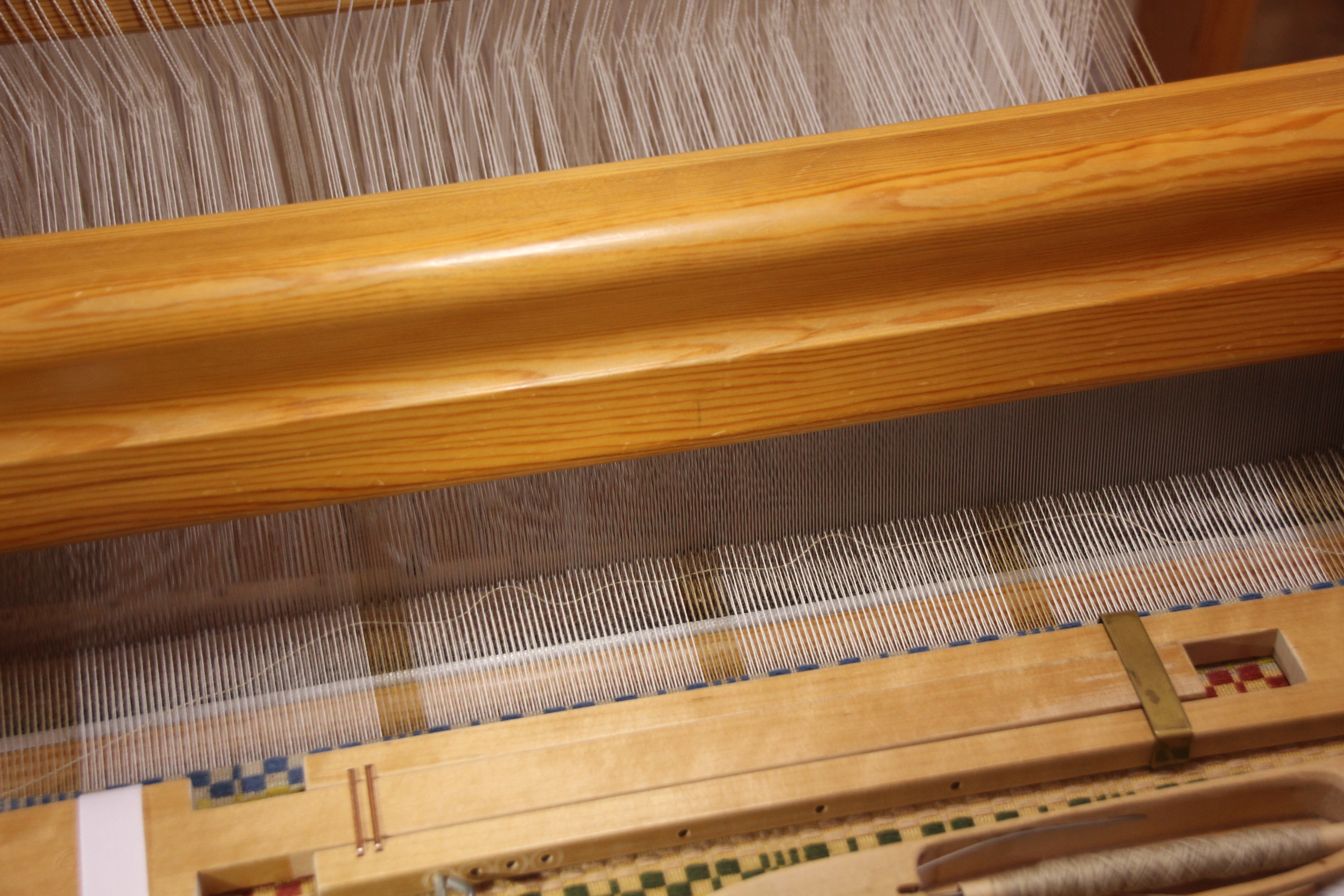 Weft rep using the beater to make wavy line.